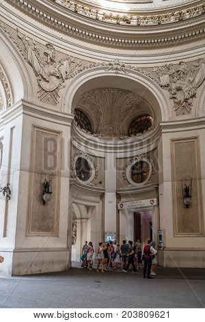 Vienna, Austria - August 16, 2017: Facade to St. Michael Square in Hofburg Palace. It has been the seat of power of the Habsburg dynasty  and today the official residence and workplace of the President of Austria. It includes Spanish Riding School