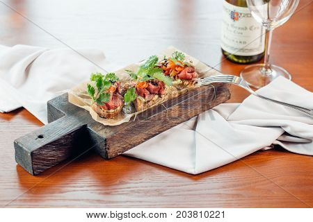 Red Fish And Arugula Sandwich On A Board, Selective Focus