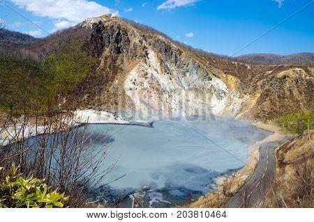 Oyunuma hot-water marsh and Mt. Hiyori Rises in Hell Valley Noboribetsu Hokkaido Japan.
