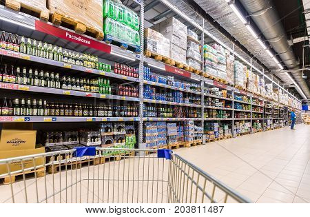 Samara Russia - September 5 2017: Alcoholic beverages. Shelfs of beverage domestic and imported beer cans and bottles at the Lenta store in Samara Russia