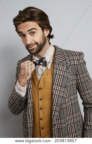 Geek guy fashion in bow tie and jacket portrait