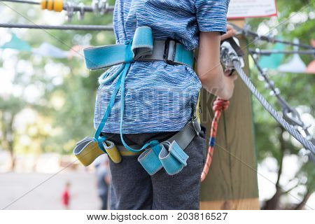 Safe Climbing extreme sport with and Carabiner. Safety equipment. recreation extreme sports overcoming of obstacles.