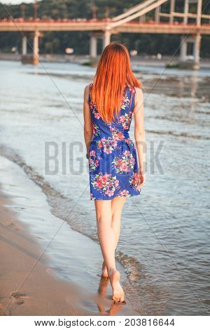 Beautiful legs of a beautiful girl walking in the water barefoot. Recreation