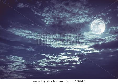Beautiful Night Sky With Dark Cloudy. Some Clouds Overshadow The Full Moon.
