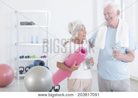 Grandmother Holding Pink Fitness Mat