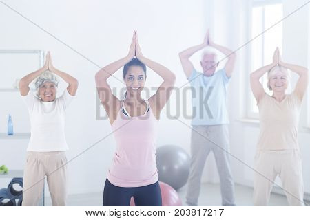 Elderly People In Yoga Pose
