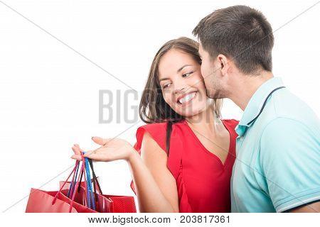Boyfriend Kissing Girlfriends Cheek At Shopping