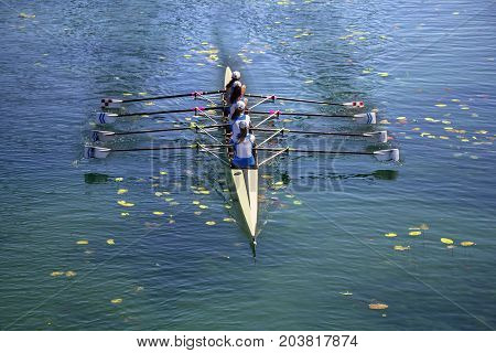 Ladies fours rowing team in race on the lake
