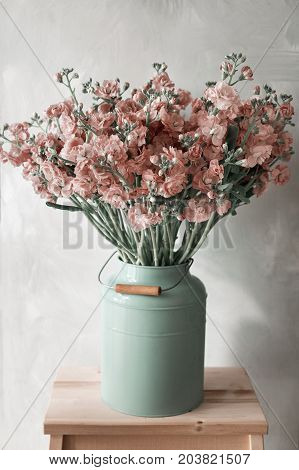 Garden scene with flowers in vintage metal cans, real vertical photo, daylight, intage styling