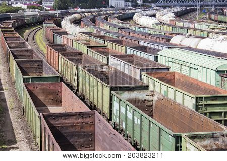 A lot of empty rail cars. A loaded coal train transporting coal. A lot of different cars
