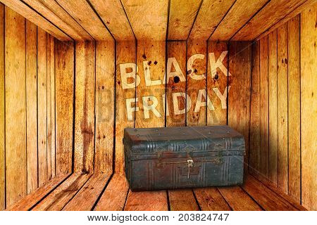 old iron treasure box and black friday words background in wooden room treasure trove for you concept