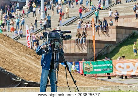 A Journalist With A Video Camera On A Tripod