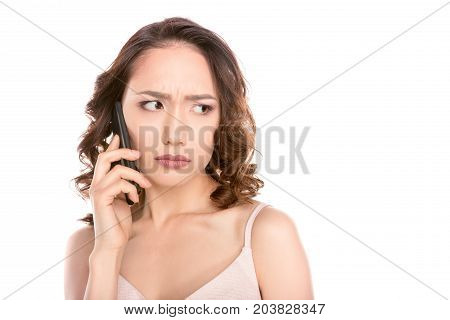 Frowning Girl With Smartphone