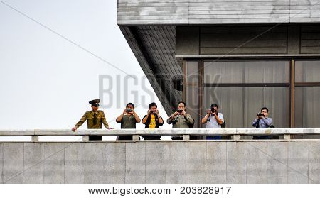 PANMUNJOM, SOUTH KOREA - SEPTEMBER 26, 2014: The North Korea soldiers and tourists on the north korean military office building at Korean Demilitarized Zone, Panmunjom