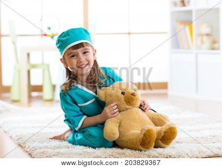 Smiling kid girl pretending she is a doctor in hospital