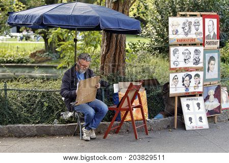 KARLOVY VARY, CZECH REPUBLIC - AUGUST 14: In the streets you can be painted or have a cartoon from folk artists in Carlsbad Czech republic on August 14 2017