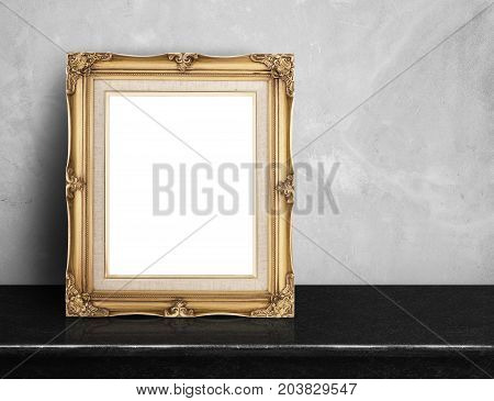 Blank Gold Victorian Picture Frame On Black Marble Table At Grey Concrete Wall,template Mock Up For
