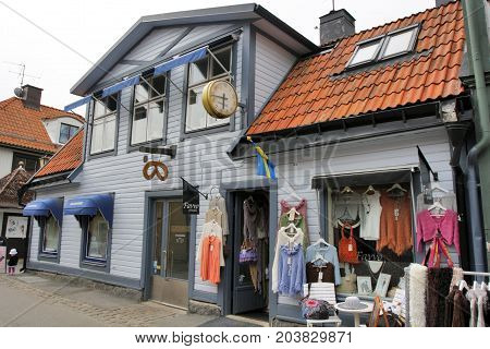 SIGTUNA, SWEDEN - JULY 29: Sigtuna is the oldest city in Sweden and is located about 50 Km northwest of Stockholm in Provinz Uppland. Shoping in historical buildings in Sigtuna Sweden on July 29 2012