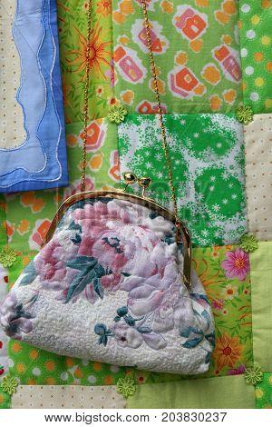 Details of handbag on a carpet background
