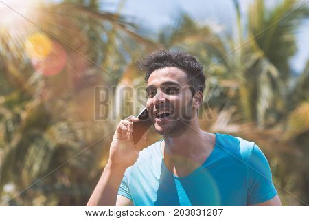 Hispanic Man Talking Phone Call Over Tropical Forest Background Happy Smiling Mix Race Latin Guy Speaking Holding Mobile Conversation