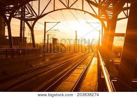 Railway station at platform in the eveningSunset of railroad tracks
