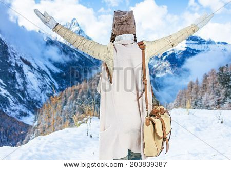 Traveller Woman In Front Of Winter Mountain Scenery Rejoicing