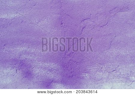 Background of a purple stucco coated and painted exterior rough cast of cement and concrete wall texture decorative coating
