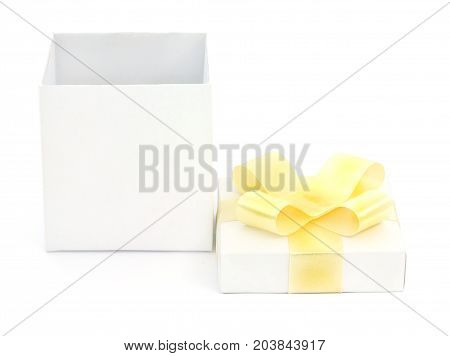 White gift box with a yellow bow on white background