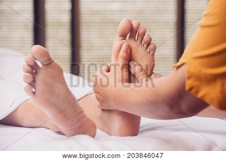 Foot massage in the spa salon, close up