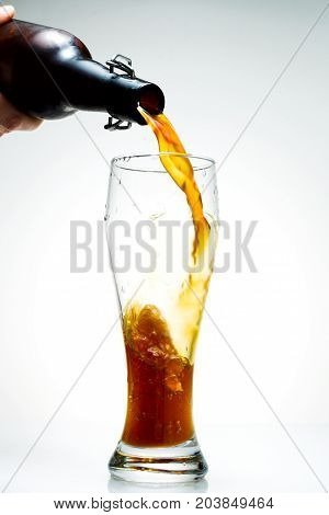Beer Is Pouring From A Bottle