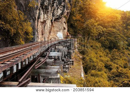 Train ride on the Death railway (river Kwai Thailand). Death Railway train passing over the Tham Krasae Viaduct. Thai-Burma Railway