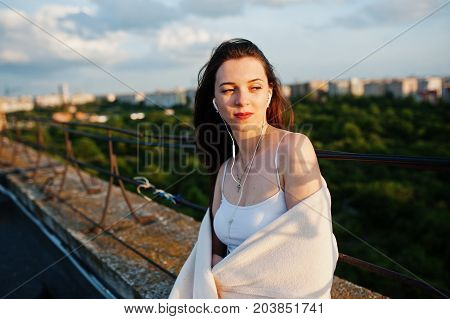 Portrait Of A Beautiful Young Woman In Casual Clothes Covered With White Shawl Or Blanket Sitting On