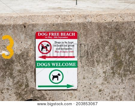 a sign for dogs on the beach dog free beach and dog welcome Harwich ; England; UK
