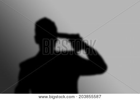Shadow of man with pistol gun turned on his head wants to commit suicide. light and shadow poster
