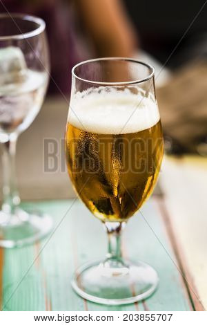 a glass of beer on a table