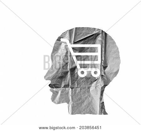 Crumpled paper shaped as a human head and shopping cart on white background. Safety and secrets concept.