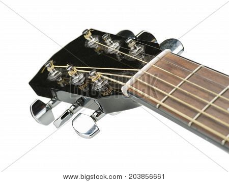 Detail of classic guitar with shallow depth of field. Closeup image of acoustic guitar fingerboard, Photography classical guitar on a light background.