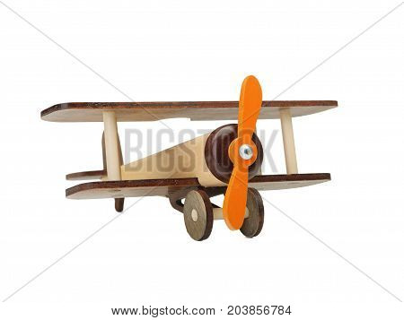 Wooden toy airplane isolated on white, close-up of an eco-friendly product for children's games, isolated on a white background. A developing toy airplane. Fight simulation.