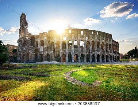 Ruins of great colosseum at the sunset