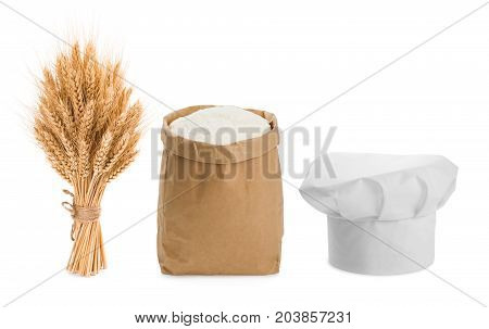 Sheaf of wheat chefs hat and flour isolated on white