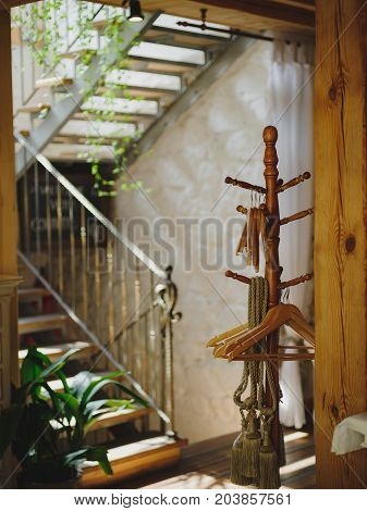 Exquisite interior of a modern and expensive restaurant. Waiting for guests. Sunny Day. Background blur. Wooden stairs leading to the second floor. Modern urban style.