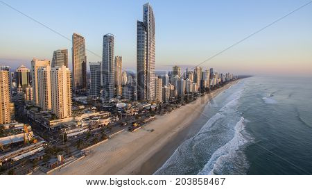 GOLD COAST, AUSTRALIA - SEPTEMBER 3 2017: Aerial view of Surfers Paradise and famous coast line at sunrise, with a view looking down the famous beach.