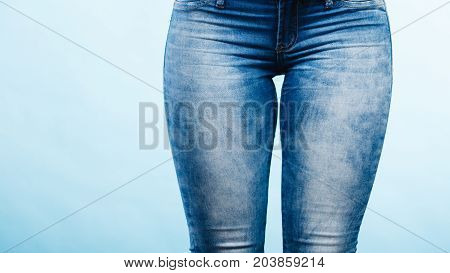 Clothing fashion part body concept. Woman hips with jeans.
