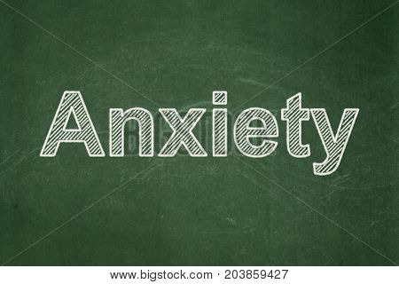 Healthcare concept: text Anxiety on Green chalkboard background