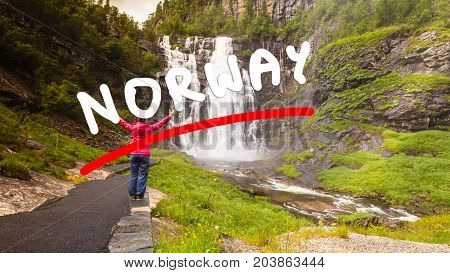 Tourist Woman By Skjervsfossen Waterfall - Norway