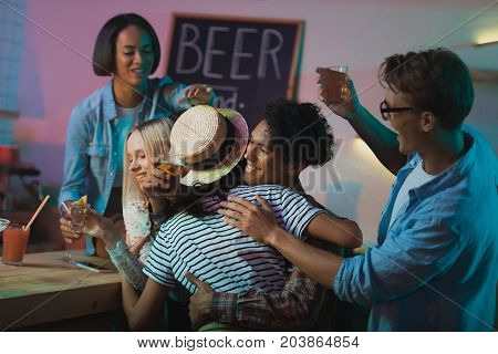 Multicultural People Greeting Friend At Party