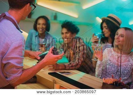 Barman Mixing Cocktail