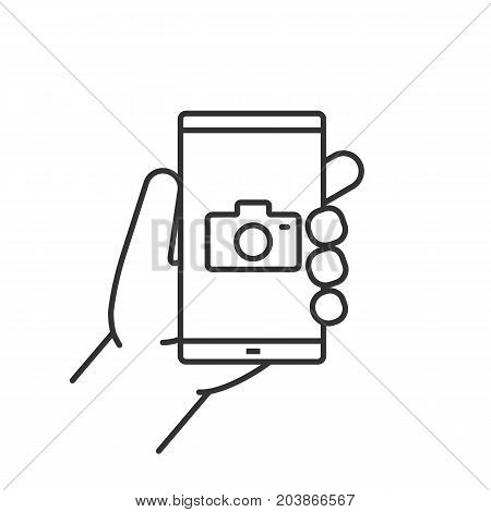 Hand holding smartphone linear icon. Thin line illustration. Smart phone photocamera. Contour symbol. Vector isolated outline drawing