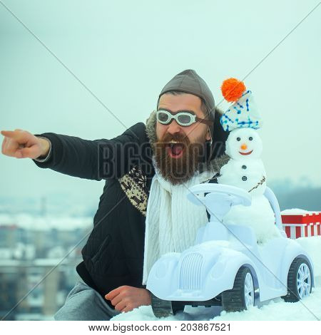 Bearded Man In Pilot Hat And Glasses Pointing Finger