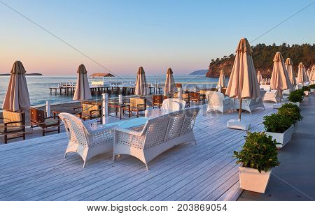 Scenic view of sandy beach on the beach with sun beds and umbrellas open against the sea and mountains. Hotel. Resort. Tekirova-Kemer. Turkey